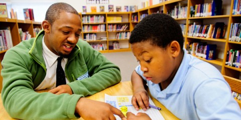 William Walker, a DC College Success Foundation scholarship recipient, gives back by mentoring at student at Petree Elementary School in Winston-Salem.  Walker is a student at Winston Salem State University.(Photography by Artisan Image/ © 2011)
